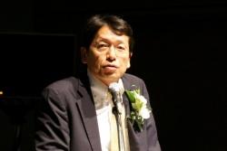 自動運転のシミュレーション活用について講演する日産の吉澤隆氏
