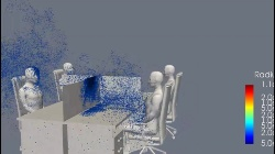 間仕切りがある席でせきをした場合のシミュレーション。左は高さ120センチメートル、右は高さ140センチメートル。120センチメートルでは飛沫が多く正面の人にかかってしまっている