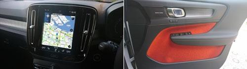 大型のセンターパネルの両脇に空調の吹き出し口を配置したのは級車種と共通するが、助手席の前などにあしらわれたアルミのドット調の化粧パネル(左)や、オレンジ色のドア内張り(右)など、より遊び心を感じさせるデザインだ