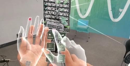 HMDの前に手をかざすと、操作ボタンの画像が表示される(資料:飛島建設)