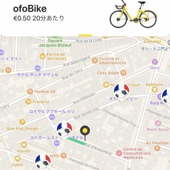 専用スマホアプリの画面(日本語対応)。周囲にofoの自転車が見当たらない場合は、アプリで空き自転車の場所を検索できる。地図中、フランス国旗とサッカーボールを組み合わせた丸い印に自転車がある。市内に点在しており、100~200メートルほど歩けば行き当たるイメージだ。ただし、スマホが示す位置に自転車がいないケースもある