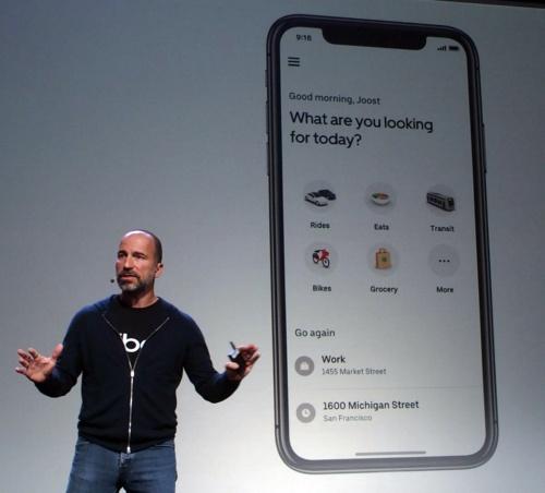 将来の統合アプリのホーム画面。食品配達サービスとおぼしき「Grocery」というアイコンもあった。スライドはウーバー(撮影:日経 xTECH)