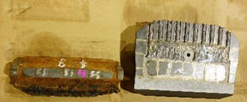 シールド機の前面の外周側に取り付けるカッタービット。施工中に摩耗するため、交換しなければならない。左は交換前、右は交換用のビット(写真:大成建設)