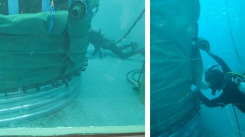 ファスナー付きの防水シートをライナープレートに被覆している様子。仮留めを解除し、シートを1枚ずつ引き上げ、ファスナーで連結しながら全体を覆っていく(写真:YKK)