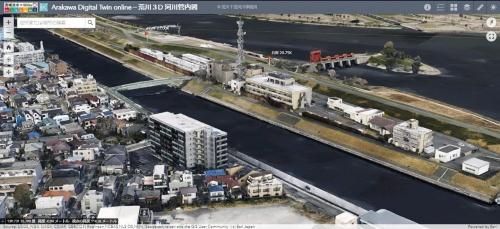 荒川・デジタルツイン・オンラインの画面。ブラウザー上で表示して操作できる。流域市街地の3次元モデルには、外壁や窓などをテクスチャーとして貼り込んだ。現時点では閲覧のみで、データのダウンロードや加工はできない(資料:国土交通省荒川下流河川事務所)