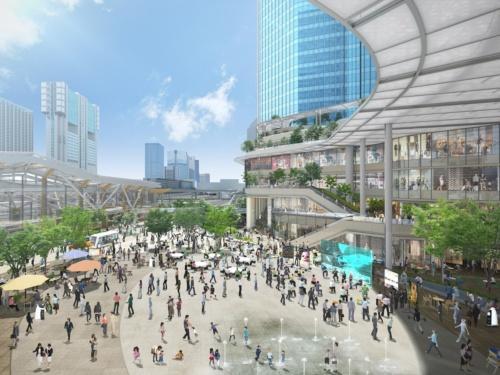 品川新駅(仮称)の前に整備する歩行者広場の完成イメージ。左が、品川新駅。デザインアーキテクトに隈研吾氏を起用し、2020年春に暫定開業を予定している。右が、品川開発プロジェクト第1期の4街区南棟(資料:JR東日本)