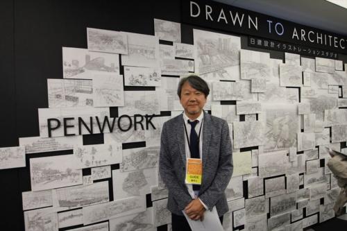 日建設計設計部門イラストレーションスタジオ室長の山田雅明室長が来場者の質問に答えた(写真:日経アーキテクチュア)