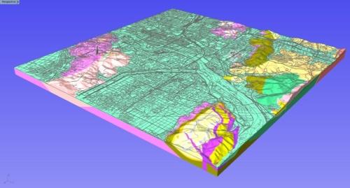 3次元モデルの広域図。ある都市の3次元モデルを作成したもの。緑色の部分が柔らかい地盤で、黄色や朱色が硬い地盤であることを示している(資料:応用地質)