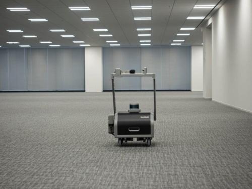 鹿島が開発した照度測定・調整ロボット。竣工前に照明設備の照度が設計値通りになるよう検査・調整する際に使用する(写真:鹿島)