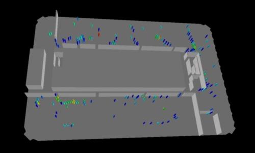 建物の外周部に配置した執務室から避難するシミュレーションの画像。青や緑の点が人を表す。色の違いは、歩行速度の違いを示している(資料:大成建設)