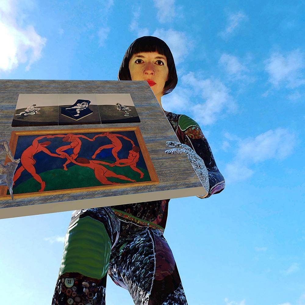 建物の壁を軽々と持ち上げる女性の巨人。服装はやたら派手 (出所:スパイラル)(C)Cie Gilles Jobin