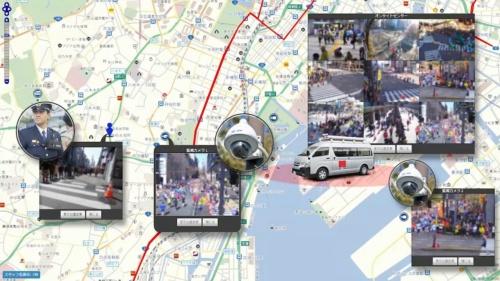 マラソンコースのあちこちに、監視カメラと小型のウエアラブルカメラを胸に付けた警備員を配置。撮影した画像は解析する「セコムセンター」に送り、結果をコース近くに停めた監視車両(オンサイトセンター、写真中央の車)に送る