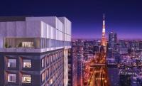 東京・六本木に1月24日に開業する「三井ガーデンホテル六本木プレミア」の完成イメージ。図の左に立つ建物が同ホテルで、最上階には、東京タワーの眺めを楽しめるテラス付きレストラン・バーを置く。東京タワーなども至近距離にある