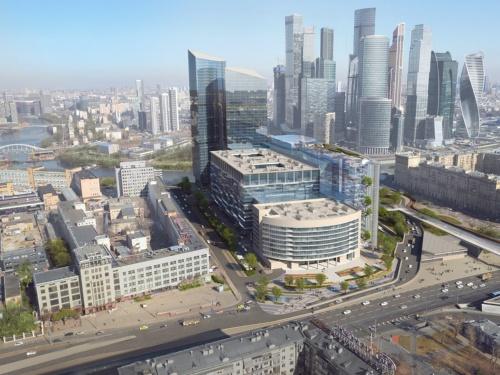 南側から見る。隣接する中層2棟、高層2棟の建物は既存。ズベルバンク・シティーは、全体をまとめるようにシンプルなダブルスキンのファサードにした(資料:日建設計)