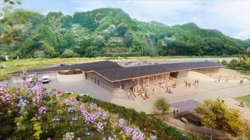 「まきのさんの花畑」からの外観イメージ。緩やかにカーブする屋根が2つの切妻屋根を結ぶ。駐車場(山側)と広場(手前の花畑側)を、建物によって明確に切り離している(資料:STUDIO YY)