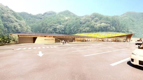 メインアプローチからの外観イメージ。おおらかな屋根が「まきのさんの花畑」の風景を切り取り、象徴的なアプローチ空間をつくっている。建物左手が「おもちゃミュージアム」、右手の屋根が跳ね上がっているのが「まきのさんの市場」(産直・物販エリア)。その間に「まきのさんの台所」(食堂・レストラン)(資料:STUDIO YY)
