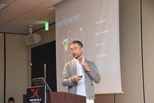 TEAM マーケティング Head of Asia Salesの岡部恭英氏。サッカー世界最高峰UEFAチャンピオンズリーグに関わる初のアジア人であり、現在はアジア・パシフィック地区の放映権とスポンサーシップセールスの責任者を務めている