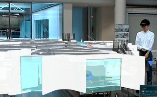 花岡氏が設計した建物を10分の1スケールで空間上に表示したときの様子。HoloLensをかぶっている人には、このように建物が見える(写真:竹中工務店)