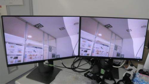 現実空間に仮想のガラスを浮かべるようにして見たときの様子。透明なガラスの画像がある部分は、現実空間の見え方が少し違っている(写真:日経クロステック)