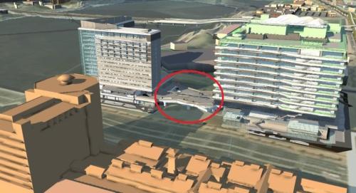 清水建設が21年秋の開業を計画する「豊洲6丁目4-2・3街区プロジェクト(仮称)」。オフィス棟とホテル棟から成り、中間に都市型道の駅「豊洲MiCHiの駅」(赤い丸の部分)を整備する。この画面では2つの建物を、BIM(ビルディング・インフォメーション・モデリング)データを使って正確に描写している(資料:清水建設)