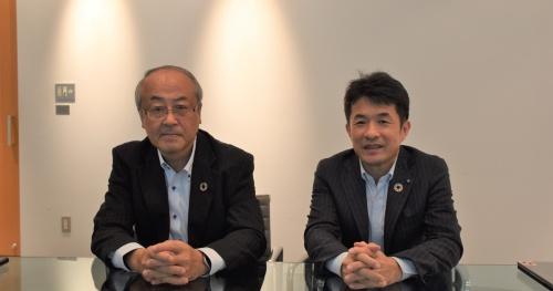 左が大林組で技術本部長を務める梶田直揮常務。右が同社グループ経営戦略室の堀井環・経営基盤イノベーション推進部長(写真:日経アーキテクチュア)