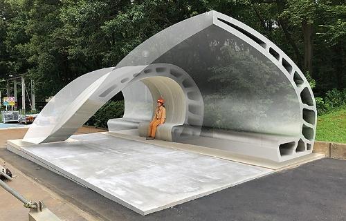 図1■シェル型ベンチの完成イメージ。12部材から成る。大林組設計本部設計部教育施設課の松永成雄副課長は、「3Dプリンターでなければ実現できないデザインを意識し、曲面や中空を採り入れた」と話す(資料:大林組)