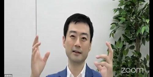 講演する武藤真祐氏