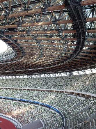 国立競技場の内観(19年12月撮影)。社会の要請を受け、持続性を持つ建物をつくらないとならない。「木や鉄、コンクリートはそれぞれ耐久性が異なる。素材の特性を見極め、メンテナンスの計画を反映させながらどうつくり上げるか。どんな建物でも大切な考え方になる」(川野氏)(写真:吉田 誠)