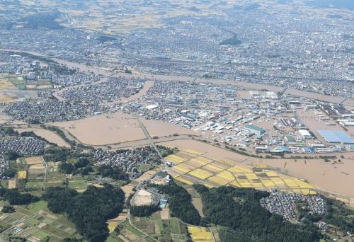 〔写真2〕大雨で阿武隈川が氾濫