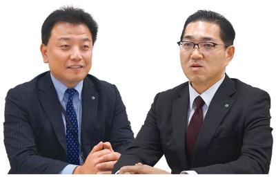 総合企画部の石川秀典課長(左)とシステム部の井上浩一課長(右)