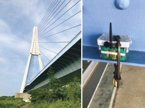 写真2■ 茨城県の新那珂川大橋。「sonas x01」という省電力マルチホップ無線を搭載したセンサーユニットを取り付けている(写真:ソナス)
