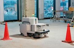 Preferred Networks(PFN)と鹿島が共同で開発した、建築現場用の自律移動清掃ロボット「raccoon(ラクーン)」。建築現場はサービスロボットにとって実用化へのハードルが非常に高い応用先である。(写真:PFN)