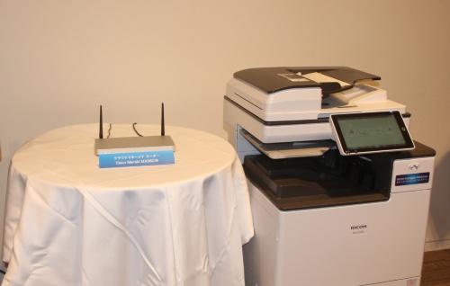 クラウドに対応したリコーの複合機と接続回線を担うシスコシステムズの無線LAN製品