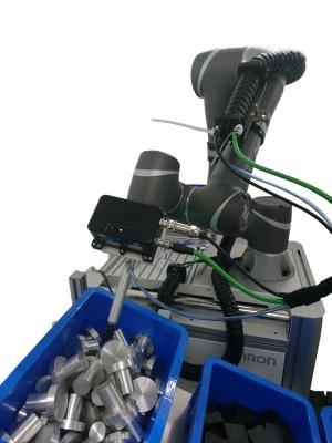 図1:アーム形協調ロボット「TM」シリーズと3D画像センサーを組み合わたピッキングシステムのイメージ