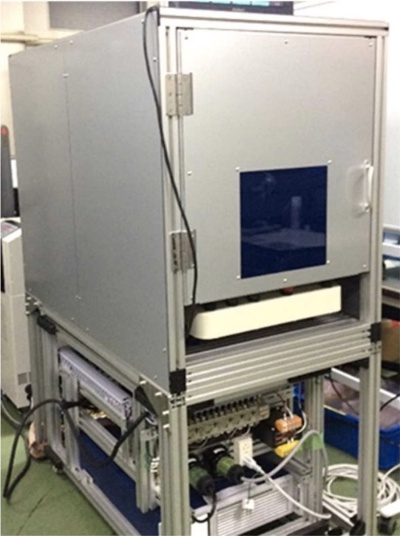 図3:清和光学製作所が開発したフラットパネル用溶着機