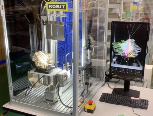 ロビットが開発した自動カットロボット